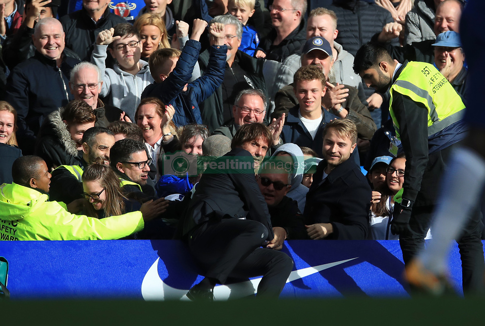 Chelsea manager Antonio Conte is mobbed by fans after Chelsea's Cesar Azpilicueta (not pictured) scores his side's third goal of the game