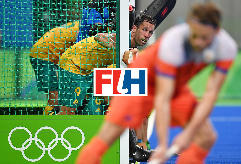 Australia's Mark Knowles looks from the goal during the men's quarterfinal field hockey Netherlands vs Australia match of the Rio 2016 Olympics Games at the Olympic Hockey Centre in Rio de Janeiro on August 14, 2016. / AFP / MANAN VATSYAYANA        (Photo credit should read MANAN VATSYAYANA/AFP/Getty Images)