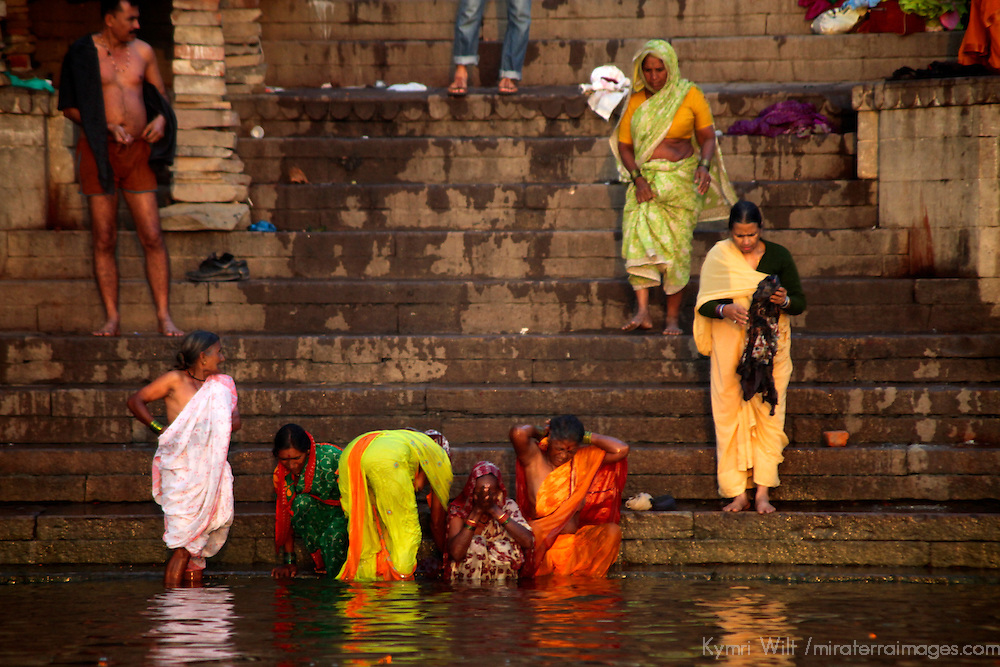 Asia, India, Varanasi. Women in colorful saris bathing in the Ganges River.