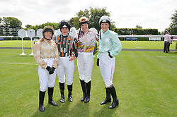 Left to right, CLARE SALMON, MAGGIE BUGGIE, ALEXIS GREEN and LEONORA SMEE at the 2014 Glorious Goodwood Racing Festival at Goodwood racecourse, West Sussex on 31st July 2014.