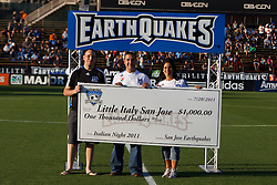 July 20, 2011; Santa Clara, CA, USA;  Competitive eater Joey Chestnut (left) presents a check in honor of Italian night before the game between the San Jose Earthquakes and the Vancouver Whitecaps at Buck Shaw Stadium.