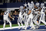 Dallas Cowboys outside linebacker Damien Wilson (57) and a group of Cowboys teammates celebrate in the end zone with Dallas Cowboys cornerback Jourdan Lewis (27) after Lewis intercepts a late fourth quarter pass and runs it back 7 yards to the New Orleans Saints 16 yard line on the game winning turnover as the time clocks winds down during the NFL week 13 regular season football game against the New Orleans Saints on Thursday, Nov. 29, 2018 in Arlington, Tex. The Cowboys won the game 13-10. (©Paul Anthony Spinelli)