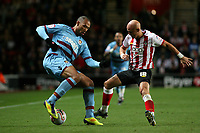 Football - The Championship - Southampton vs. West Ham United<br /> John Carew of West Ham United and Southampton's Richard Chaplow in action at St Mary's Stadium Southampton
