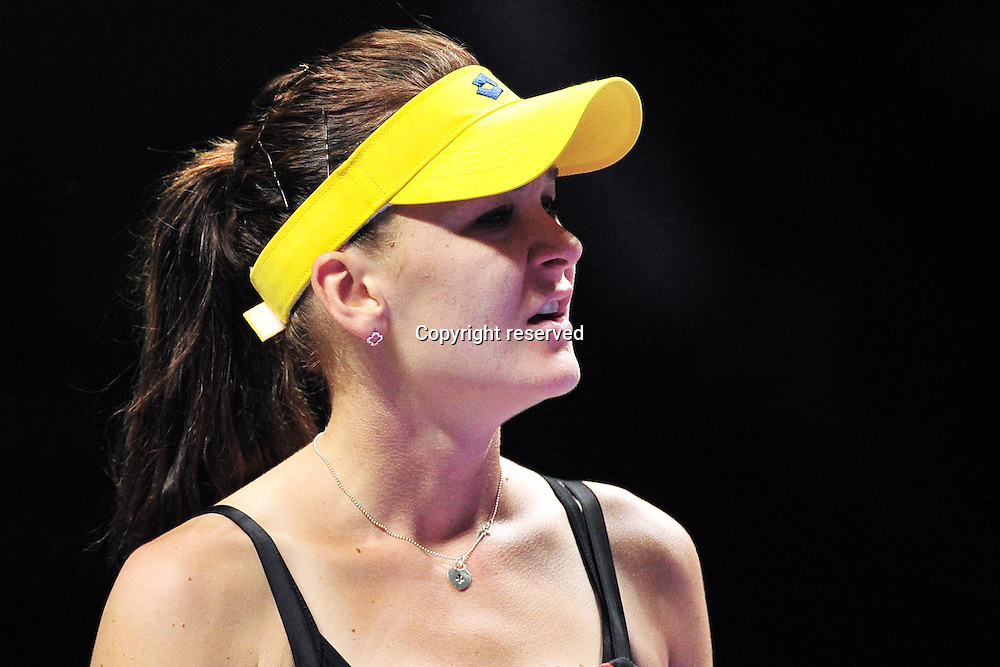 25.10.2014. Singapore. Polands Agnieszka Radwanska reacts during for womens singles semi-final match against Romanias Simona Halep at the WTA Tennis womens finals at the Singapore Indoor Stadium on Oct. 25, 2014. Agnieszka Radwanska lost 0-2.