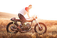 Backlit lifestyle portrait of man with custom cafe racer. Image is model released. Photo by Robert Zaleski/rzcreative.com