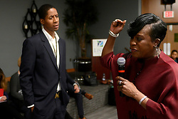 Councilwoman Cherelle Parker is seen cutting short an unidentified VisionQuest employee after he attempted to verbally attack community members, during a heated and packed meeting between neighbors and representatives of VisionQuest, on Thursday. (Bastiaan Slabbers for WHYY)