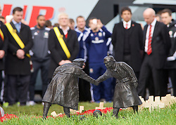 FLANDERS, BELGIUM - Monday, November 17, 2014: Wales' manager Chris Coleman and FAW President Trefor Lloyd-Hughes lay a wreath at the war memorial to the Welsh soldiers at Flanders Field in Belgium. (Pic by David Rawcliffe/Propaganda)