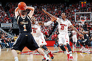 LOUISVILLE, KY - DECEMBER 2: Chris Smith #5 and Russ Smith #2 of the Louisville Cardinals defend against Brad Tinsley #1 of the Vanderbilt Commodores at KFC Yum! Center on December 2, 2011 in Louisville, Kentucky. Louisville defeated Vanderbilt 62-60 in overtime. (Photo by Joe Robbins) *** Local Caption *** Chris Smith;Russ Smith;Brad Tinsley