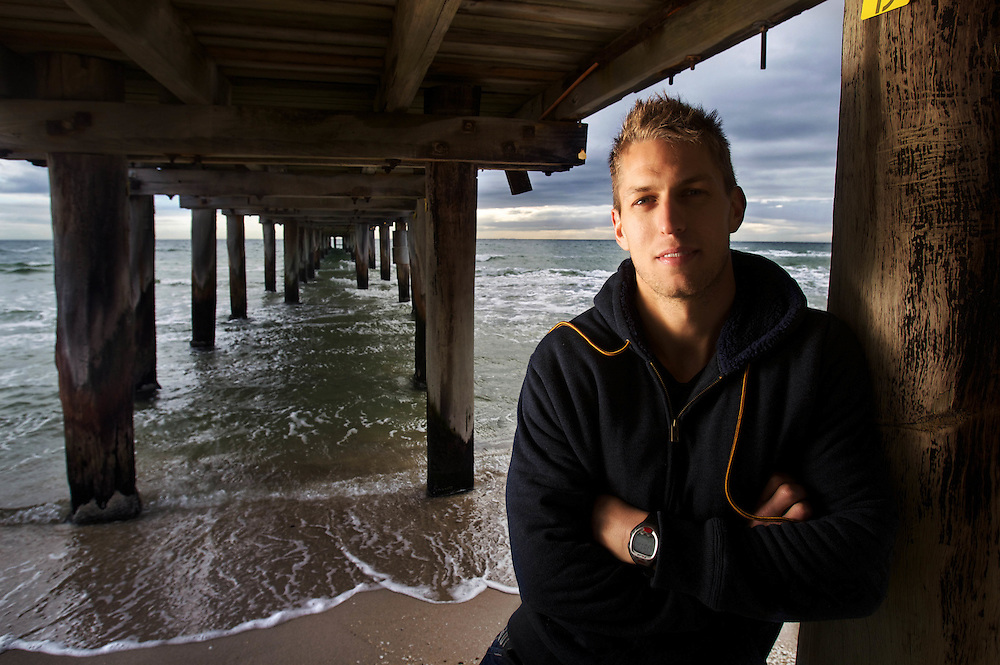 St Kilda footballer Sean Dempster on Seaford Beach. Pic By Craig Sillitoe CSZ / The Sunday Age.8/08/2012 melbourne photographers, commercial photographers, industrial photographers, corporate photographer, architectural photographers, This photograph can be used for non commercial uses with attribution. Credit: Craig Sillitoe Photography / http://www.csillitoe.com<br />