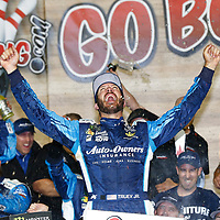 May 13, 2017 - Kansas City, Kansas, USA: Martin Truex Jr. (78) takes the checkered flag and wins the Go Bowling 400 at Kansas Speedway in Kansas City, Kansas.