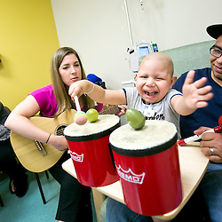 Patient Fernando Hernandez, age 4, plays with shakers and a drum during a pediatric cancer music-therapy session with music therapist Mary Brieschke (second from left) at St. Luke's MSTI Pediatrics in Boise, Idaho. Fernando's parents Noemi Vega (left) and Luis Hernandez (right) are also pictured. Tuesday June 2, 2015