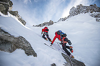 A team of moutnaineers, as seen ascending a snowfield leading to the ridge of Aiguilles Marbrées.