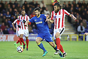 AFC Wimbledon defender Jon Meades (3) dribbling and battles for possession with Lincoln City midfielder Michael Bostwick (16) during the The FA Cup match between AFC Wimbledon and Lincoln City at the Cherry Red Records Stadium, Kingston, England on 4 November 2017. Photo by Matthew Redman.