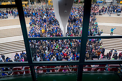 Crowd of attendees wait for doors to open at We Day 2015, Seattle, Washington. Free the Chldren event which inspires youth activism and volunteering.