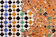Old / restored Moroccan zelij mosaic wall / doorway tiling, El Badi Palace, Marrakesh, Morocco, 2016–04-22.<br /><br />The El Badi Palace and sunken gardens are a short walk from Bahia, within the old, towering Medina walls of the Mellah. <br /><br />A ruined palace, the site is being renovated and restored, but remains to be many peoples favourite Marrakesh palace experience. <br /><br />Commissioned by the Arab Saadian sultan Ahmad-al-Mansur and completed in 1593, the complex took 25 years to build and is considered to be some of the finest examples of Saadian architecture in Moroco.