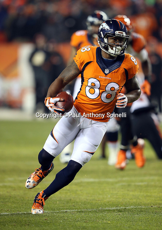 Denver Broncos wide receiver Demaryius Thomas (88) runs with the ball as he catches a pass with 18 seconds left on the clock before halftime during the 2015 NFL week 16 regular season football game against the Cincinnati Bengals on Monday, Dec. 28, 2015 in Denver. The Broncos won the game in overtime 20-17. (©Paul Anthony Spinelli)