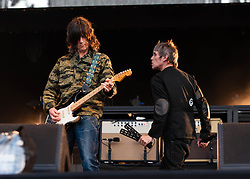 "© Licensed to London News Pictures. 07/06/2013. London, UK.   John Squire (left) and Ian Brown (right) of The Stone Roses performing live at Finsbury Park. The Stone Roses are an English rock band formed in Manchester in 1983, consisting of vocalist Ian Brown, guitarist John Squire, bassist Gary ""Mani"" Mounfield, and drummer Alan ""Reni"" Wren. They were one of the pioneering groups of the Madchester movement that was active during the late 1980s and early 1990s.   Photo credit : Richard Isaac/LNP"