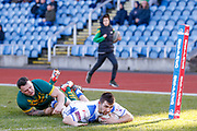 Workington Town winger Sam Forrester (2) scores a try  during the Ladbrokes Challenge Cup round 3 match between Hunslet Club Parkside and Workington Town at South Leeds Stadium, Leeds, United Kingdom on 24 February 2018. Picture by Simon Davies.