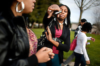 Vallejo High School students Ashley Kelly, 16, right, with friend, Auzunique Johnson, 16, left, points out the location of the nearby gas station frequented by high school students and the scene mob assault by teenagers last week on a city construction worker, in Vallejo, Ca., on Wednesday, Feb. 10, 2010
