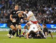 Twickenham, GREAT BRITAIN, Right, Steve BORTHWICK, reaches out to hold All Black, prop Nemmia TIALATA, during the Investic Challenge, England vs New Zealand, Autumn International at Twickenham Stadium, Surrey on Sat 29.11.2008 [Photo, Peter Spurrier/Intersport-images]