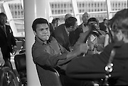 Muhammad Ali In Dublin..1972..11.07.1972..07.11.1972..11th July 1972..Prior to his fight against Al 'Blue' Lewis at Croke Park, Dublin, former World Heavyweight Champion, Muhammad Ali arrives at Dublin Airport. The fight was part of his build up for for a championship fight against the current World Champion, 'Smokin'  Joe Frazier. Ali had been stripped of the title partly due to his refusal to join the American military during the Vietnam War,which he had opposed...Photo of Muhammad Ali comically threatening a photographer with a shillelagh.
