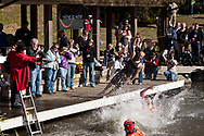 CNN Hero Doc Hendley and Founder of Wine To Water plunges into Chetola Lake during the Blowing Rock NC Polar Plunge to raise money for the NGO.