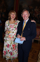CAROLE STONE and her husband RICHARD LINDLEY at a reception to open an exhibition entitled 'Boucher Seductive Visions' at The Wallace Collection, Manchester Square, London W1 on 29th September 2004.NON EXCLUSIVE - WORLD RIGHTS