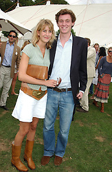 LADY CANDIDA BALFOUR and MR JESSE MOTION at the 2004 Cartier International polo day at Guards Polo Club, Windsor Great Park, Berkshire on 25th July 2004.