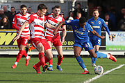 AFC Wimbledon attacker Michael Folivi (41) with a shot on goal during the EFL Sky Bet League 1 match between AFC Wimbledon and Doncaster Rovers at the Cherry Red Records Stadium, Kingston, England on 9 March 2019.