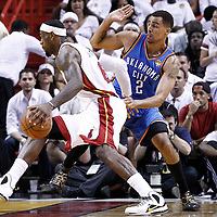 19 June 2012: Miami Heat small forward LeBron James (6) drives past Oklahoma City Thunder shooting guard Thabo Sefolosha (2) during the first quarter of Game 4 of the 2012 NBA Finals, Thunder at Heat, at the AmericanAirlinesArena, Miami, Florida, USA.