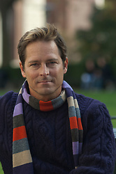 good looking man in scarf outdoors