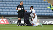 Semi Ajayi goes off injured during the Sky Bet League 2 match between Oxford United and AFC Wimbledon at the Kassam Stadium, Oxford, England on 10 October 2015.