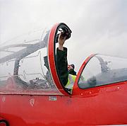 Engineering ground staff of the Red Arrows, Britain's RAF aerobatic team, makes last pre-flight checks before training flight.