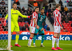 STOKE-ON-TRENT, ENGLAND - Saturday, January 25, 2020: Swansea City's Rhian Brewster (R) with Stoke City's goalkeeper Jack Butland (L) and Danny Batth (C) during the Football League Championship match between Stoke City FC and Swansea City FC at the Britannia Stadium. (Pic by David Rawcliffe/Propaganda)