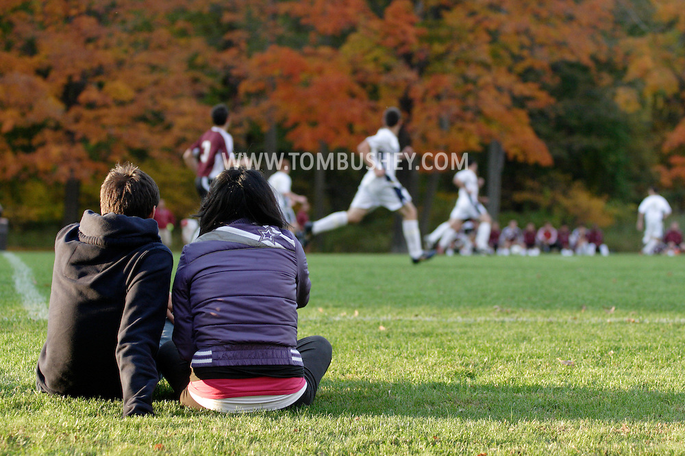 Beacon, NY - A high school boy and girl sit on the grass and watch Beacon play Ossining in a boys' soccer game in Beacon on Oct. 16, 2008.
