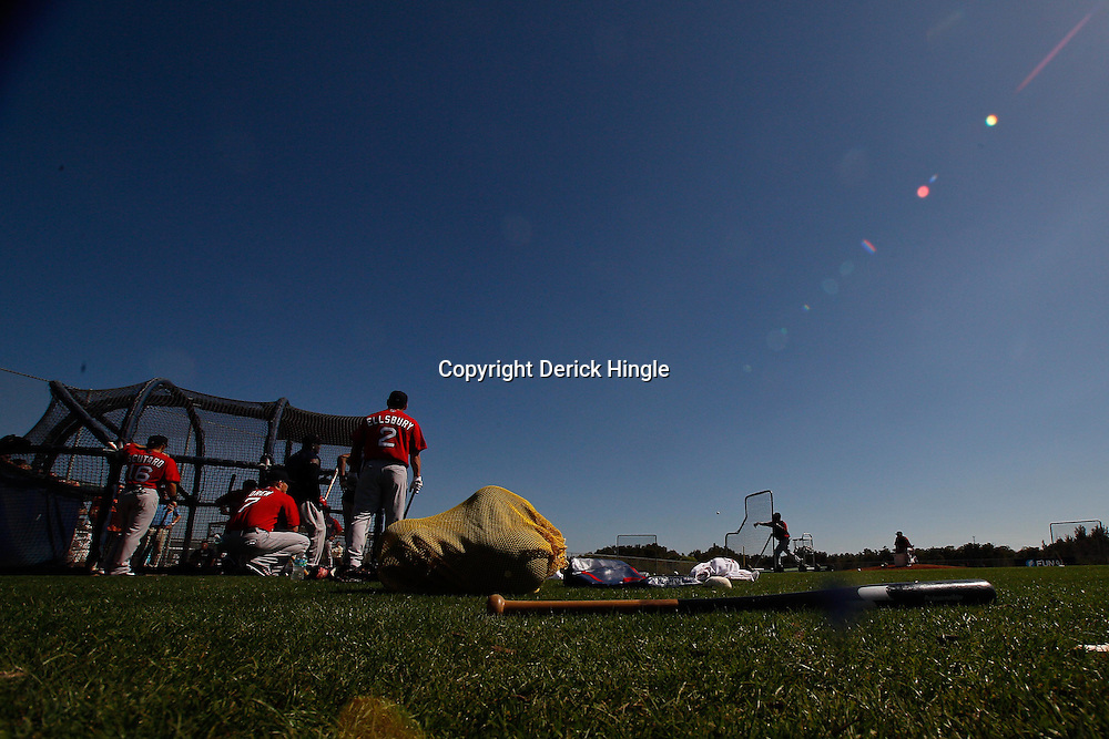 February 19, 2011; Fort Myers, FL, USA; Boston Red Sox players shortstop Marco Scutaro (16), right fielder J.D. Drew (7) and left fielder Jacoby Ellsbury (2) watch batting practice during spring training at the Player Development Complex.  Mandatory Credit: Derick E. Hingle