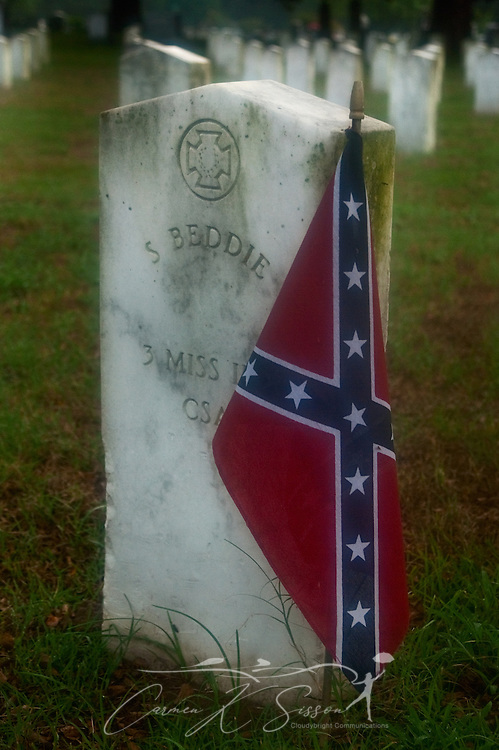 A Confederate flag decorates the grave of a Civil War veteran on a rainy, foggy afternoon in Friendship Cemetery in Columbus, Miss. The nation's first Memorial Day is believed to have taken place in the historic cemetery. (Photo by Carmen K. Sisson/Cloudybright)