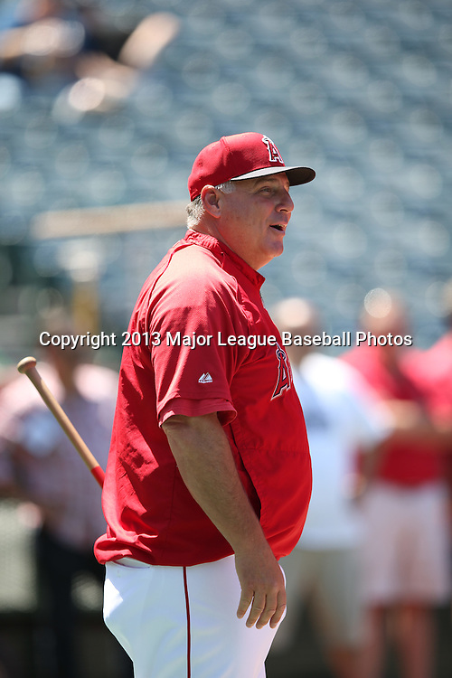 ANAHEIM, CA - JUNE 15:  Mike Scioscia #14 of the Los Angeles Angels of Anaheim laughs during batting practice before the game against the New York Yankees on Saturday, June 15, 2013 at Angel Stadium in Anaheim, California. The Angels won the game 6-2. (Photo by Paul Spinelli/MLB Photos via Getty Images) *** Local Caption *** Mike Scioscia