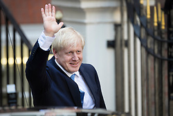© Licensed to London News Pictures. 23/07/2019. London, UK. Newly elected Conservative Party leader Boris Johnson waves as he leaves party headquarters after attending a reception. Photo credit: Peter Macdiarmid/LNP