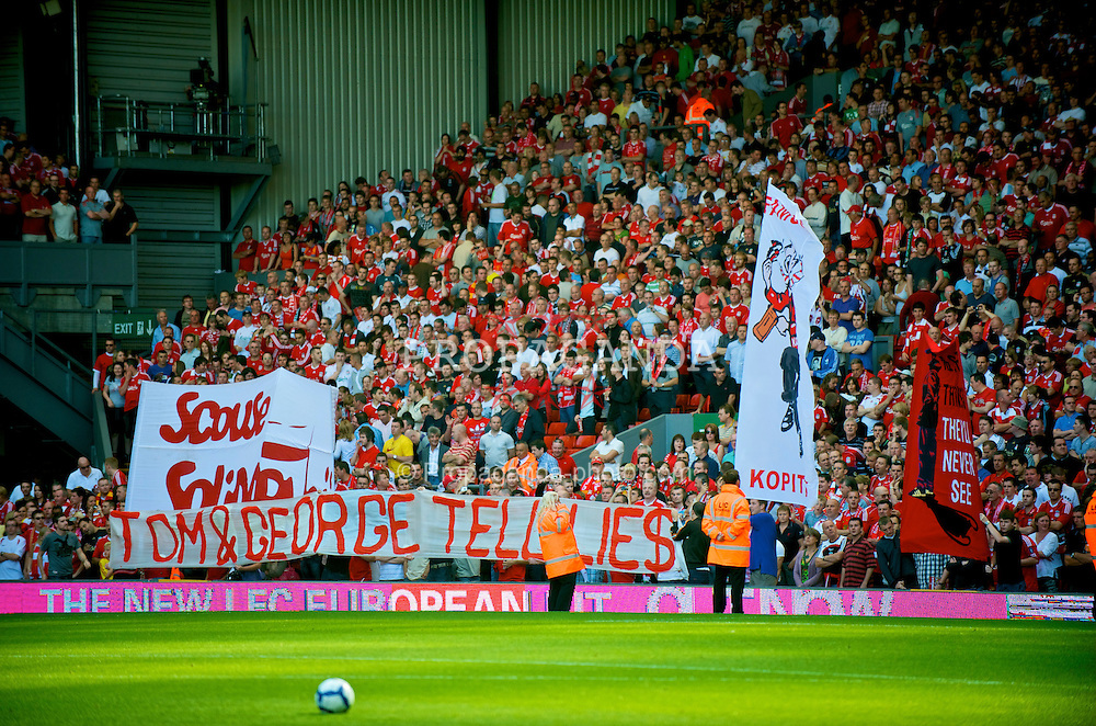 """LIVERPOOL, ENGLAND - Saturday, September 12, 2009: Liverpool supporters on the Spion Kop hold up a banner reading """"Tom & George Tell Lies