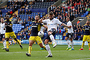 Bolton's Gary Madine scrambles the clearance away during the EFL Sky Bet League 1 match between Bolton Wanderers and Oxford United at the Macron Stadium, Bolton, England on 1 October 2016. Photo by Craig Galloway.