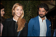 ANA KUNI & ALESSANDRO CARMICELLA at the preview of LAPADA Art and Antiques Fair. Berkeley Sq. London. 23 September 2014.