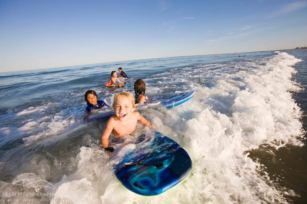 Kids on boogie boards at Hampton Beach in Hampton Beach, New Hampshire.