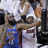 17 June 2012: Oklahoma City Thunder guard James Harden (13) goes for the layup past Miami Heat small forward LeBron James (6) during the Miami Heat 91-85 victory over the Oklahoma City Thunder, in Game 3 of the 2012 NBA Finals, at the AmericanAirlinesArena, Miami, Florida, USA.