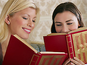 Two Young Women Friends Reading Books