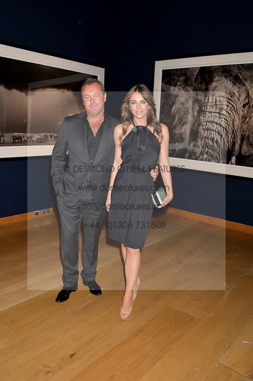 ELIZABETH HURLEY and DAVID YARROW at the Christie's Conservation Lectures in aid of Tusk held atChristie's, 8 King Street, London on 30th April 2014.