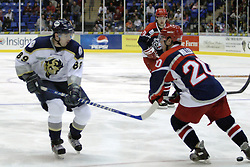11 November 2006: Mathieu Brunelle (89) and Derek Miller challenge each other for the puck.&#xD;The Elmira Jackals met the Bloomington PrairieThunder at the U.S. Cellular Coliseum in Bloomington Illinois.<br />