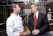 Alain Ducasse (R) and chef Jerome Lacressonniere talk in the kitchen of Beige Alain Ducasse Tokyo in the Ginza district of Tokyo, Japan on June 3 2008. .Photographer: Robert Gilhooly.