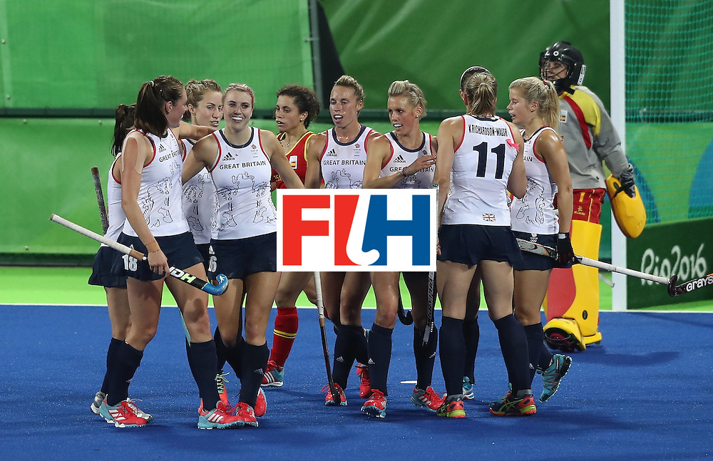 RIO DE JANEIRO, BRAZIL - AUGUST 15:  Lily Owsley  of Great Britain celebrates with team mates after scoring their third goal during the Women's quarter final hockey match between Great Britain and Spain on Day10 of the Rio 2016 Olympic Games held at the Olympic Hockey Centre on August 15, 2016 in Rio de Janeiro, Brazil.  (Photo by David Rogers/Getty Images)