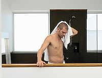 Man drying himself in bathroom